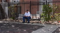 Old Man Texting Text Message In Park Bench With Smart Phone-Cell Phone