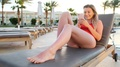 Stylish Sexy Woman In Red Bikini Using Smartphone App, Browsing The Internet